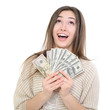 Cheerful attractive young lady holding cash, looking up and happ