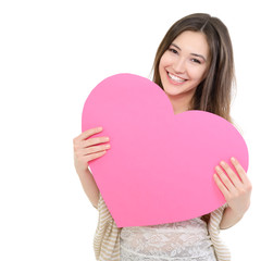 portrait of attractive happy smiling teen girl with pink heart,