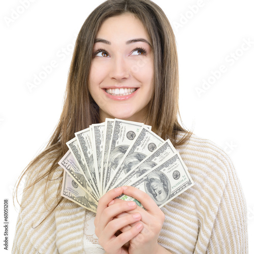 Cheerful attractive young smiling woman holding cash, dreaming a