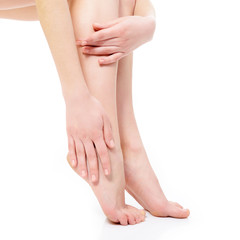 beautiful graceful female legs of young woman over white