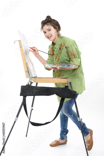 teen girl painter drawing portrait with oil paints,  professiona