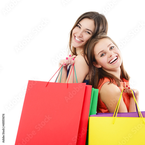 beautiful happy teen girls with colored shopping sale bags over