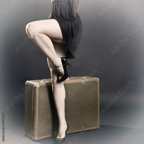 Retro stylization of traveling sexy young woman with suitcase, v