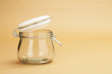 An empty jar with an open white lid