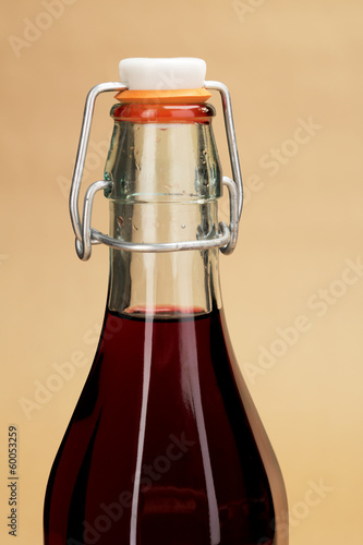 A close-up picture of a home made red wine in a classic bottle