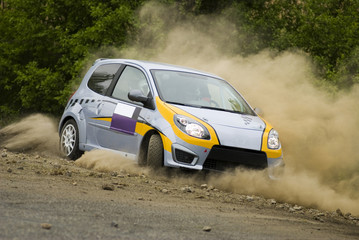 Rally car in action with big dust - Renault