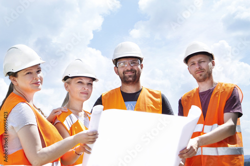 Professional engineer and a group of industrial workers.
