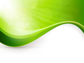 Green background with light burst and wave pattern