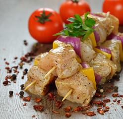 Raw chicken kebabs