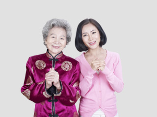 asian mother and daughter saying happy chinese new year