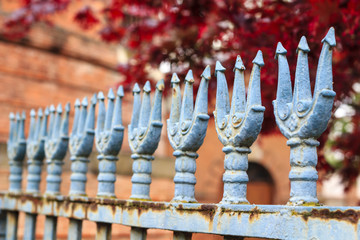 Blue painted trident fence