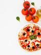 Pizza Margherita close to the ingredients like tomatoes