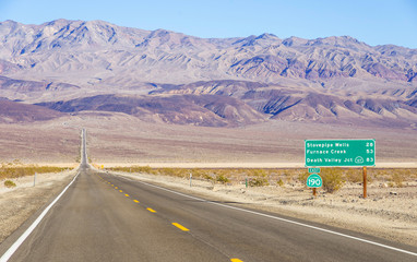 Death Valley landscape and road sign,California