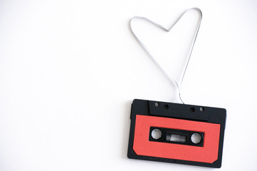 audio cassette with tape in shape of heart