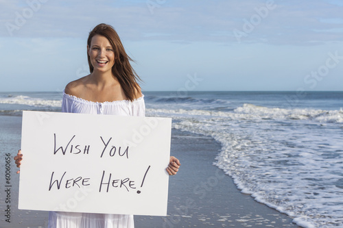 Poster Woman on Beach Holding Wish You Were Here Card