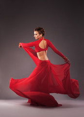 Gorgeous dancer in red clothing