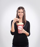 Young happy woman eating popcorn