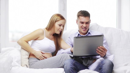happy family looking with laptop computer