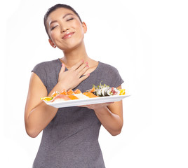 beautiful young woman holding a plate with sushi, isolated again