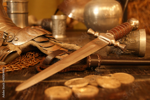 Medieval dagger on old table