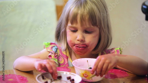Girl eating cherry