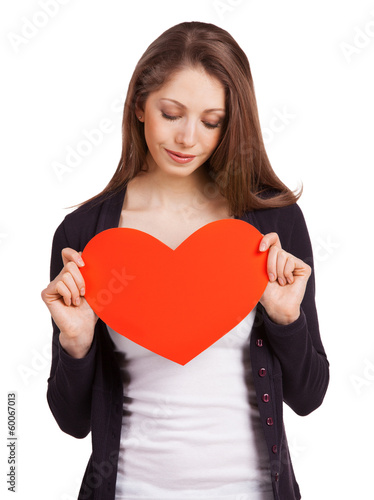 Pretty woman holding a red heart