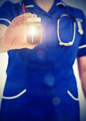 nurse holding pill jar