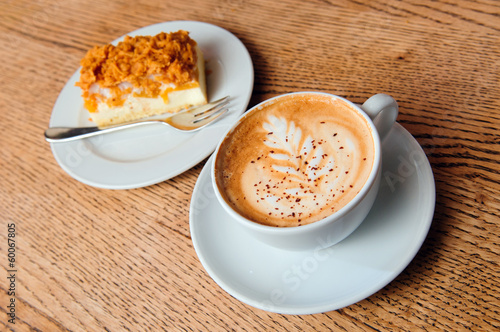 cappuccino cup with cheesecake