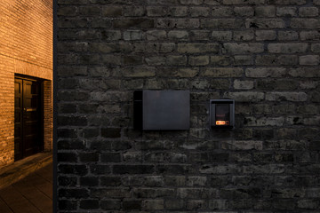 entry phone on old brick wall