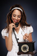 Retro young woman on the phone