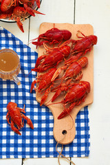 Boiled crayfish on a cutting board and beer