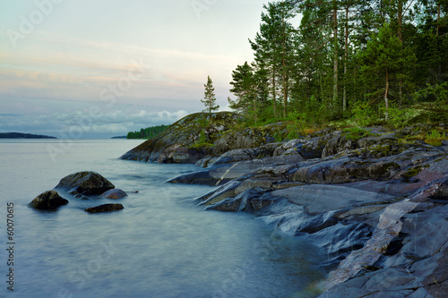 Stony shore of Ladoga lake at white night, Russia