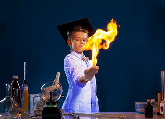 Image of witted boy holding fire in his hands
