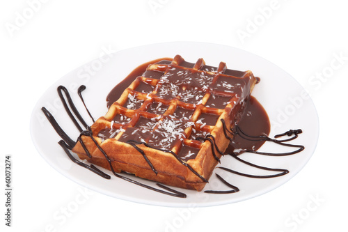 Belgian waffle with melted chocolate and coconut isolated on whi