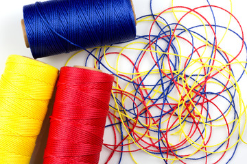 three spools of thread