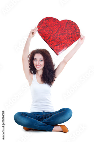Beautiful girl holding red paper heart