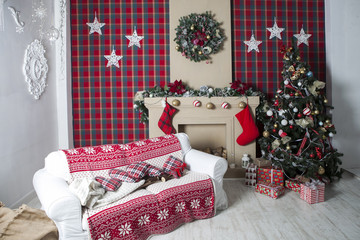 Christmas Tree and  gift boxes in  interior with fireplace