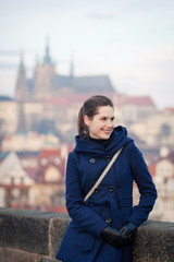 Young woman standing on the Charles Bridge in Prague