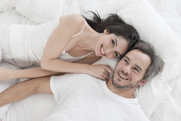 Lovely couple  lying in bed