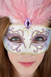 Beautiful teenage girl wearing carnival mask
