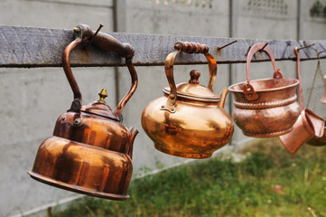 Old rusty kettles hanging