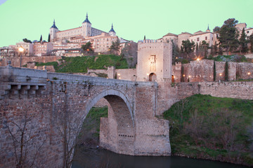 Toledo - Alcazar and Punte de Alcantara bridge in morning dusk