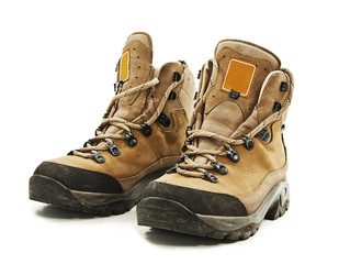 A pair of hiking boots on white background