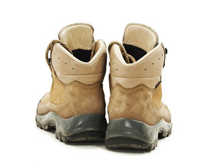A pair of hiking boots from the back on white background