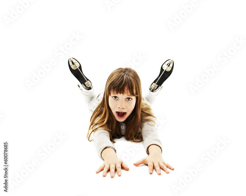 Little girl learning to skate on white background