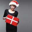 Christmass woman hold gift. Beautiful fashion model