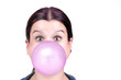 young girl with a pink bubble of chewing gum