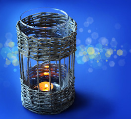 Vintage wicker lamp with a candle on the eve holiday