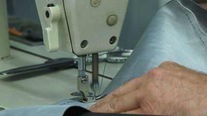 Machinist sewing. Close-up