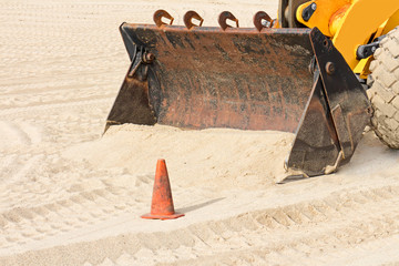 Beach backhoe industrial tractor shovel and sand